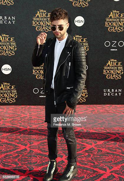 Actor Max Ehrich attends the premiere of Disney's Alice Through The Looking Glass at the El Capitan Theatre on May 23 2016 in Hollywood California