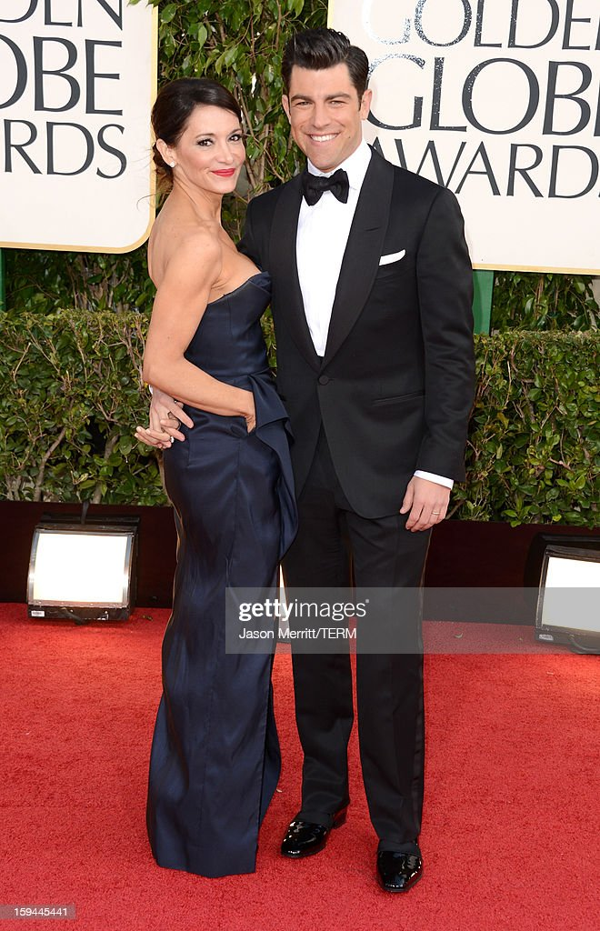 Actor Max Greenfield (R) and Tess Sanchez arrive at the 70th Annual Golden Globe Awards held at The Beverly Hilton Hotel on January 13, 2013 in Beverly Hills, California.