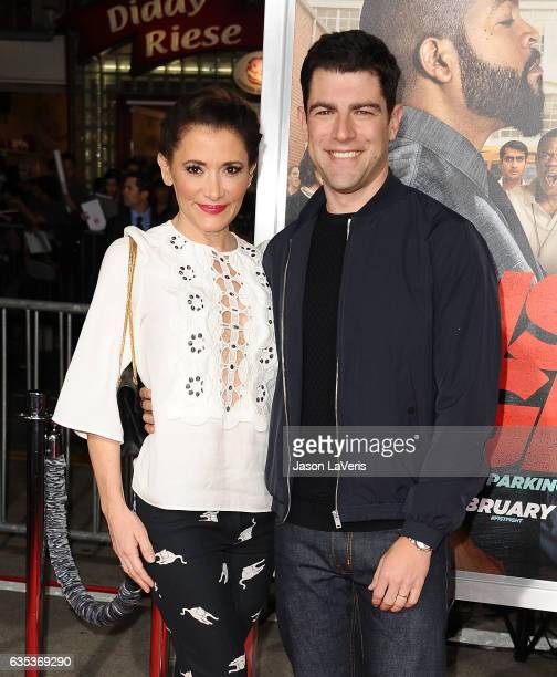 Actor Max Greenfield and wife Tess Sanchez attend the premiere of 'Fist Fight' at Regency Village Theatre on February 13 2017 in Westwood California