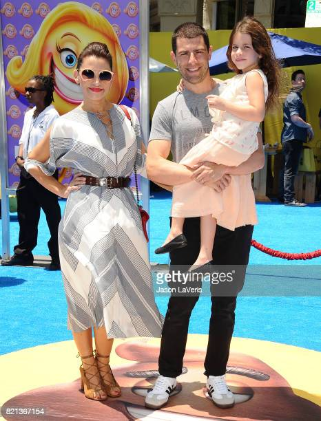 Actor Max Greenfield wife Tess Sanchez and daughter Lilly Greenfield attend the premiere of The Emoji Movie at Regency Village Theatre on July 23...