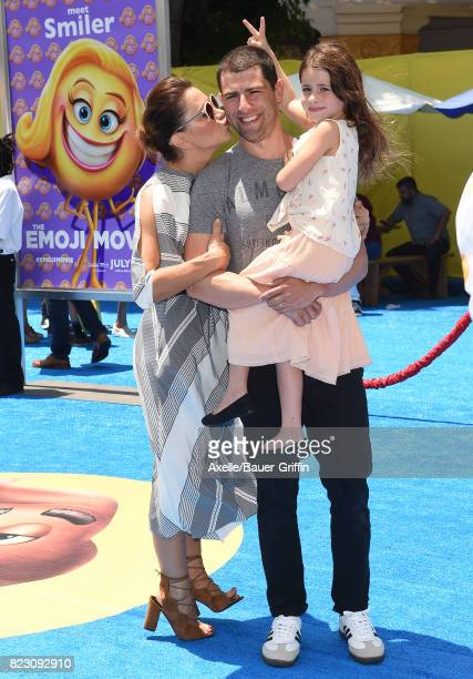 Actor Max Greenfield wife Tess Sanchez and daughter Lilly Greenfield arrive at the premiere of 'The Emoji Movie' at Regency Village Theatre on July...