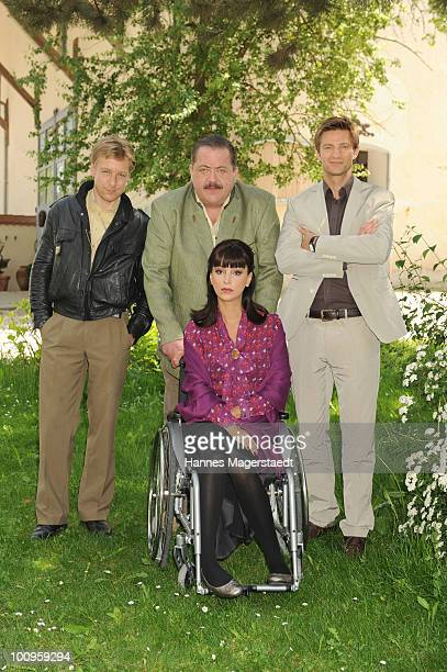 Actor Max Mueller Joseph Hannesschlaeger Wilfried Klaus and actress Verona Pooth attend the photocall of the series 'The Rosenheim Cops' on May 26...