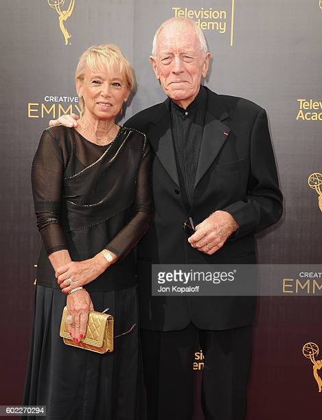 Actor Max von Sydow and wife Catherine Brelet arrive at the 2016 Creative Arts Emmy Awards at Microsoft Theater on September 10 2016 in Los Angeles...