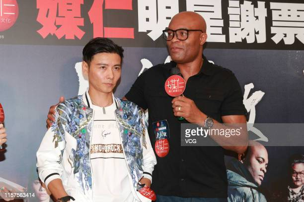 Actor Max Zhang Jin and Brazilian mixed martial artist Anderson Silva attend an activity to thank fans for their support on film 'The Invincible...