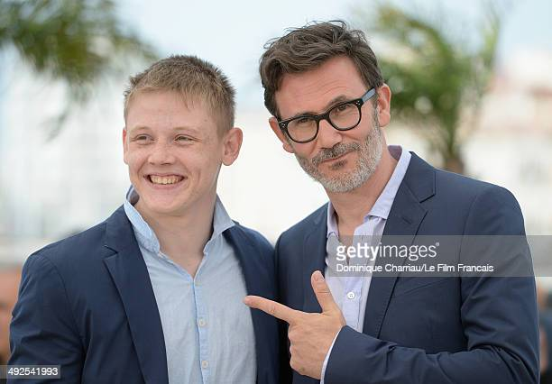 Actor Maxim Emelianov and director/producer Michel Hazanavicius attend 'The Search' photocall at the 67th Annual Cannes Film Festival on May 21 2014...