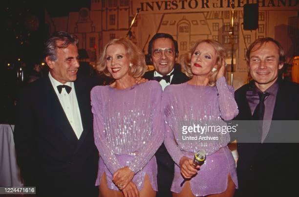 Actor Maximlian Schell, German dance and singing duo Kessler twins Alice and Ellen and actor Klaus Maria Brandauer at an evening event in...