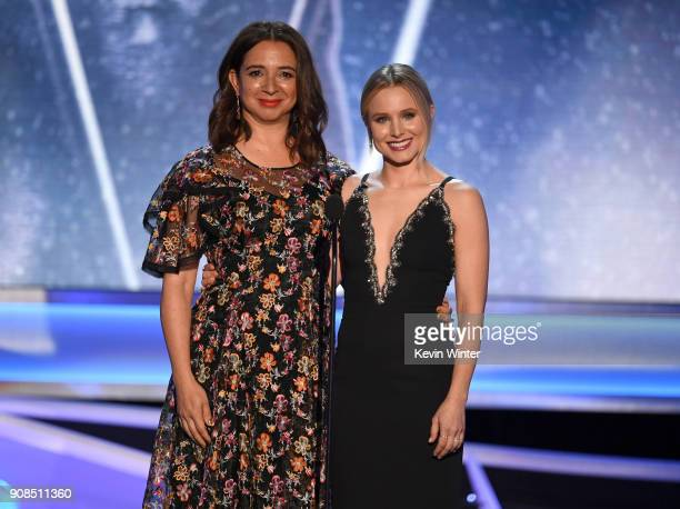 Actor Maya Rudolph and host Kristen Bell speak onstage during the 24th Annual Screen Actors Guild Awards at The Shrine Auditorium on January 21 2018...