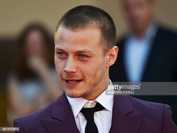 US actor Mccaul Lombardi dances as he arrives on May 15 2016 for the screening of the film 'American Honey' at the 69th Cannes Film Festival in...