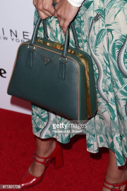 Actor Medalion Rahimi purse detail attends Marie Claire's 'Fresh Faces' celebration with an event sponsored by Maybelline at Doheny Room on April 21...