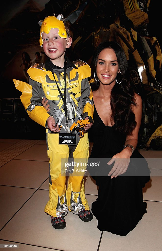 Actor, Megan Fox with Starlight Wish-child, Kai Hamilton at the UK Premiere of Transformers: Revenge of the Fallen at Odeon Leicester Square on June 15, 2009 in London, England.