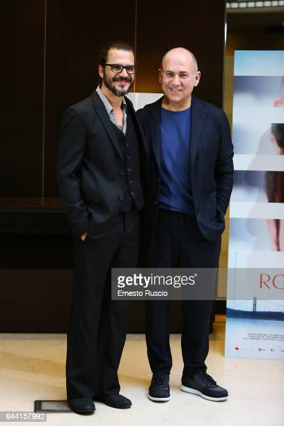 Actor Mehmet Gunsur and director Ferzan Ozpetek attend a photocall for 'Rosso Istanbul' at NH Hotel on February 23 2017 in Rome Italy