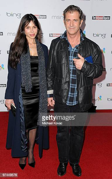 Actor Mel Gibson and girlfriend Oksana Grigorieva attend The Hollywood Reporter's Academy Awards Nominees' Cocktail Reception at The Getty House on...