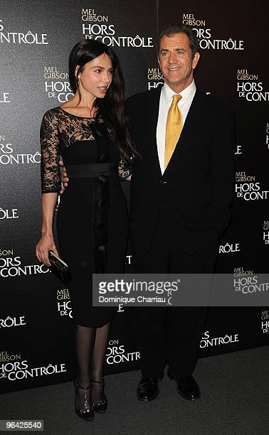 Actor Mel Gibson and Oksana Grigorieva attend the film premiere of Edge Of Darkness at Cinema UGC Normandie on February 4 2010 in Paris France