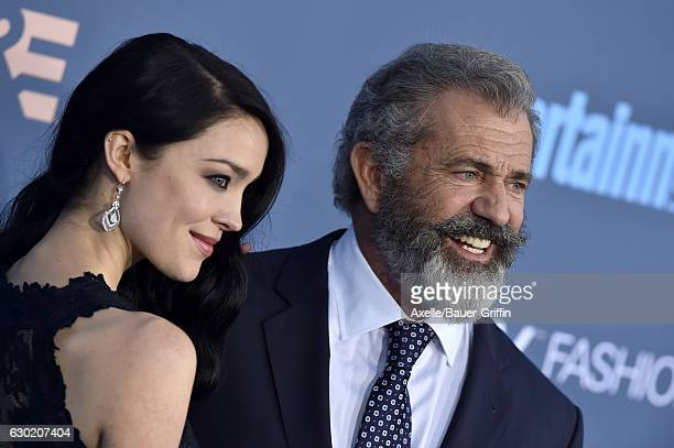 Actor Mel Gibson and Rosalind Ross arrive at The 22nd Annual Critics' Choice Awards at Barker Hangar on December 11 2016 in Santa Monica California