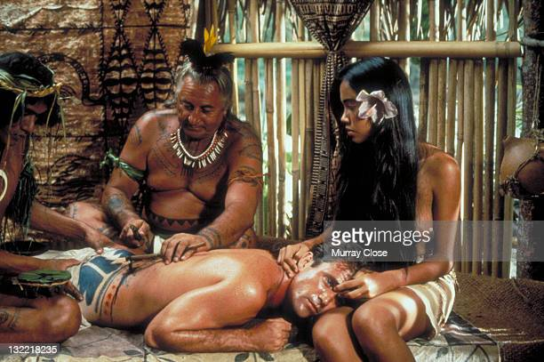 Actor Mel Gibson as mutineer Fletcher Christian and Tevaite Vernette as Mauatua in the film 'The Bounty' 1984