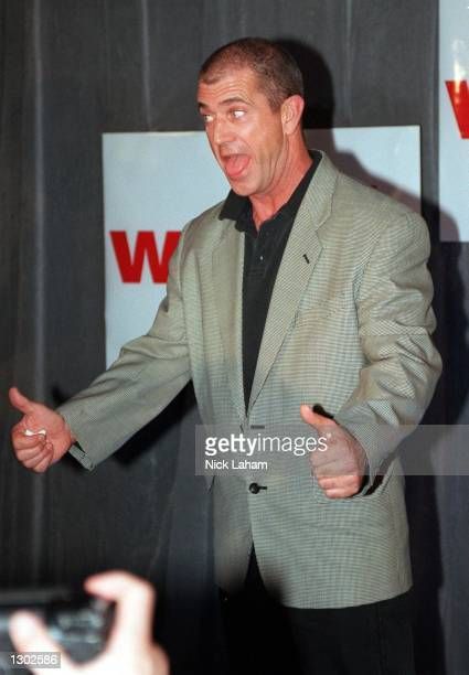 Actor Mel Gibson makes a funny gesture during a press conference to promote his new movie What Women Want October 17 2000 at the Intercontinental...
