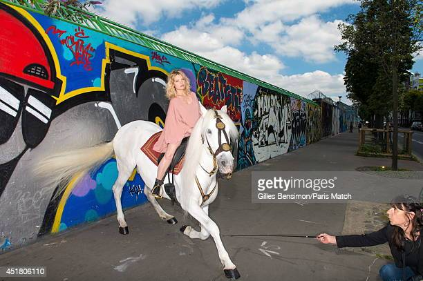 Actor Melanie Thierry riding with Nador are photographed for Paris Match at the start of the Longines Global Champions Tour Paris Eiffel on June 26...