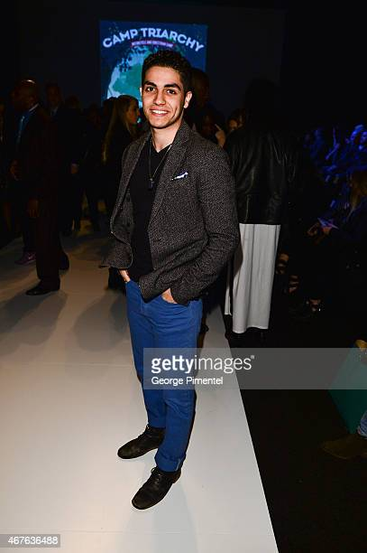 Actor Mena Massoud attends World MasterCard Fashion Week Fall 2015 Collections Day 3 at David Pecaut Square on March 25 2015 in Toronto Canada