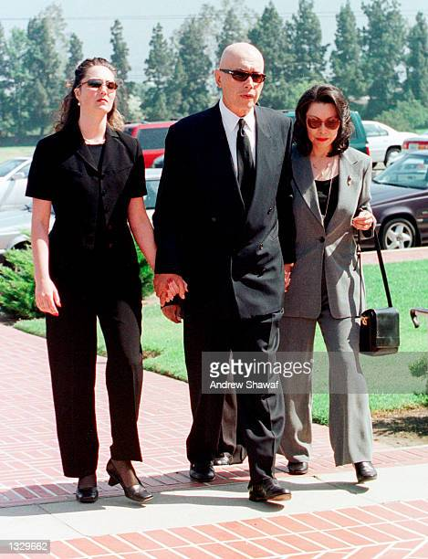 Actor Michael Ansara walks with his wife Beverly right and his late son''s fiancee Leanna Green left as they arrive at the Forest Lawn Cemetery for...
