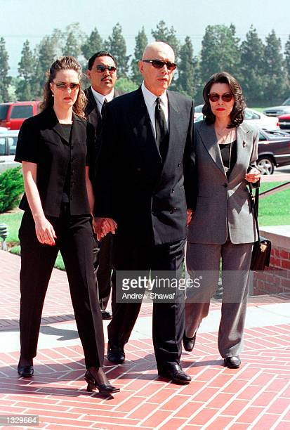 Actor Michael Ansara walks with his wife Beverly right and his late son''s fiancee Leanna Green as they arrive for the funeral service at the Forest...