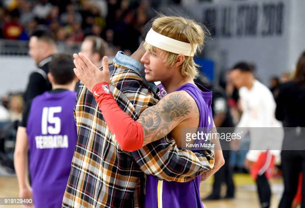 Actor Michael B Jordan and actor/recording artist Justin Bieber speak during the NBA AllStar Celebrity Game 2018 presented by Ruffles at Verizon Up...