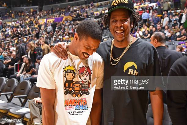 Actor Michael B Jordan and artist JayZ shares a conversation during the game on March 6 2020 at STAPLES Center in Los Angeles California NOTE TO USER...