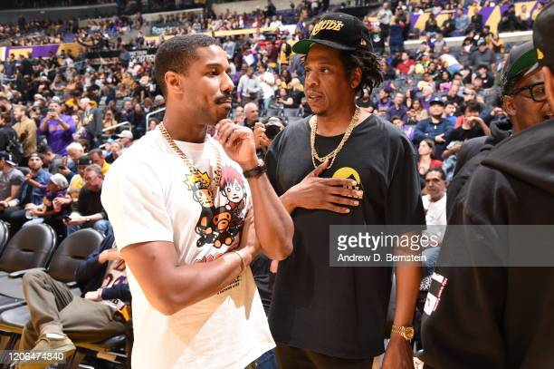 Actor Michael B Jordan and Rapper JayZ talk during the game between the Los Angeles Lakers and the Milwaukee Bucks on March 6 2020 at STAPLES Center...