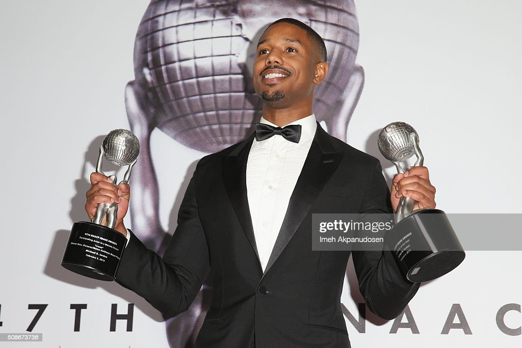 Actor Michael B. Jordan poses with his Outstanding Actor in a Motion Picture award and Entertainer of the Year award in the press room during the 47th NAACP Image Awards presented by TV One at Pasadena Civic Auditorium on February 5, 2016 in Pasadena, California.