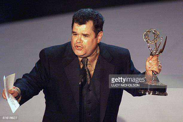 Actor Michael Badalucco holds his Emmy Award for Outstanding Supporting Actor in a Drama Series for his role in The Practiceat the 51st Emmy Awards...