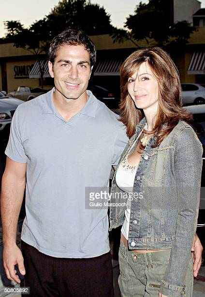 Actor Michael Bergin and Joy Tilk attend the 1 Year Anniversary Celebration for Belle Gray Boutique on May 5 2004 in Sherman Oaks California