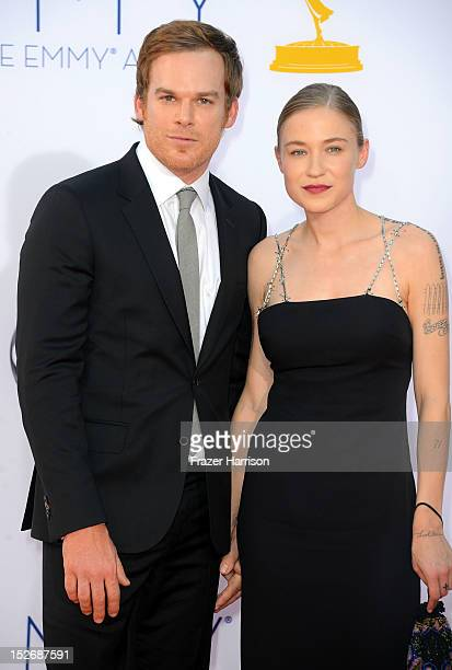 Actor Michael C Hall and Morgan Macgregor arrive at the 64th Annual Primetime Emmy Awards at Nokia Theatre LA Live on September 23 2012 in Los...