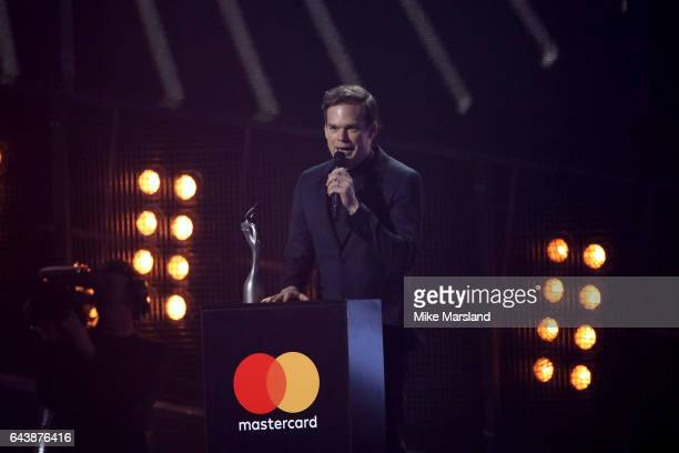 Actor Michael C Hall collects the Best British Male Solo Artist on behalf of singer David Bowie on stage at The BRIT Awards 2017 at The O2 Arena on...
