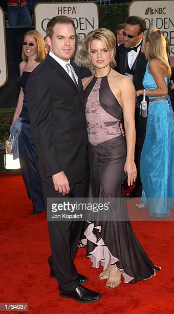 Actor Michael C Hall with wife actress Amy Spanger attends the 60th Annual Golden Globe Awards at the Beverly Hilton Hotel on January 19 2003 in...