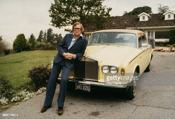 HILLS CA MAY 18 Actor Michael Caine leans on his Rolls Royce outside his Beverly Hills home His home on Cielo Drive was on the same street that the...