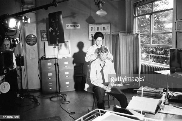 Actor Michael Caine pictured during the shooting of the film Alfie at the Old Royal Victoria Hospital Also pictured in the filming scenes are Eleanor...