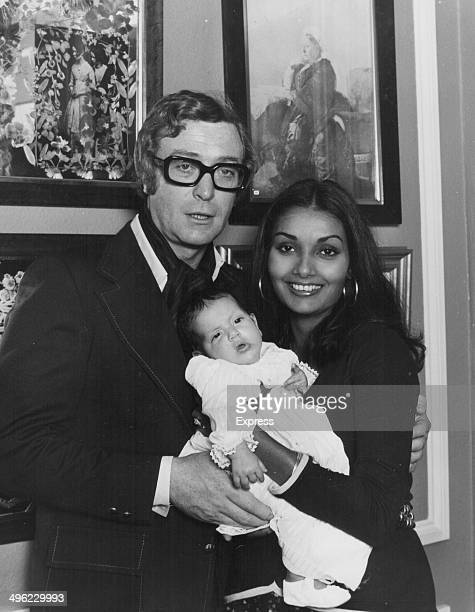 Actor Michael Caine posing with his wife Shakira and baby daughter Natasha, London, September 26th 1973.