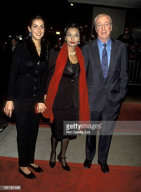 Actor Michael Caine wife Shakira Caine and daughter Natasha Caine attend the premiere of Little Voice on November 23 1998 at the Paris Theater in New...
