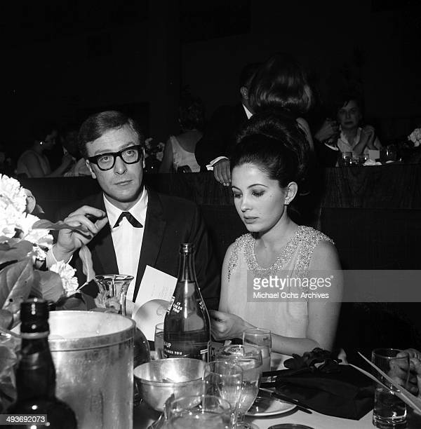 Actor Michael Caine with guest attends an award show in Los Angeles California
