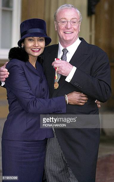 Actor Michael Caine with his second wife Shakira at Buckingham Palace in London 16 November 2000 after receiving a knighthood from Britain's Queen...