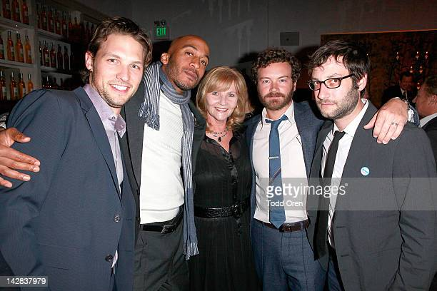 Actor Michael Cassidy actor James Lesure Carol Masterson actor Danny Masterson and actor Adam Busch pose during an evening benefiting The New York...