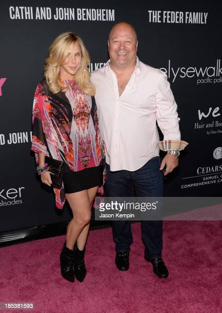 Actor Michael Chiklis and Michelle Chiklis attend Elyse Walker Presents The Pink Party 2013 hosted by Anne Hathaway at Barker Hangar on October 19...