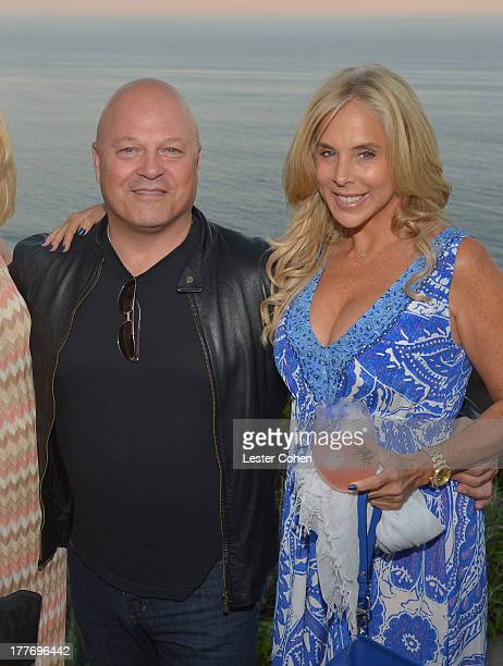 Actor Michael Chiklis and Michelle Chiklis attend Lucky Brand Celebration of California Culture and Style on August 24 2013 in Malibu California
