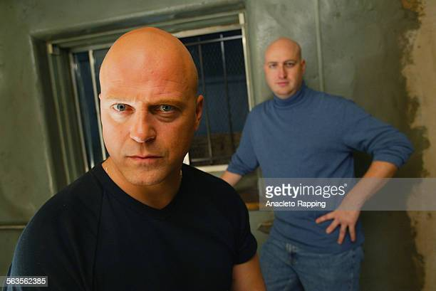 Actor Michael Chiklis and producer Shawn Ryan are photographed for Los Angeles Times on March 7 2002 on the set of 'The Shield' in Los Angeles,...