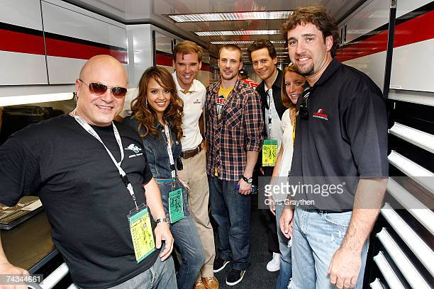 Actor Michael Chiklis stands with actress Jessica Alba team owner Ray Evernham actor Chris Evans actor Ioan Gruffudd race car driver Erin Crocker and...