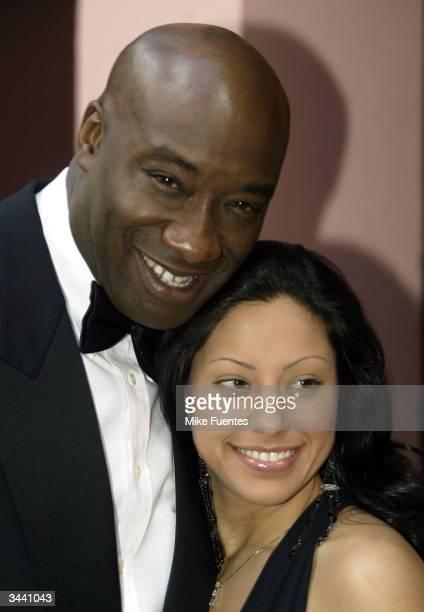 Actor Michael Clark Duncan and girlfriend Irene Marquez attend the Palm Beach International Film Festival April 17 2004 in Boca Raton Florida
