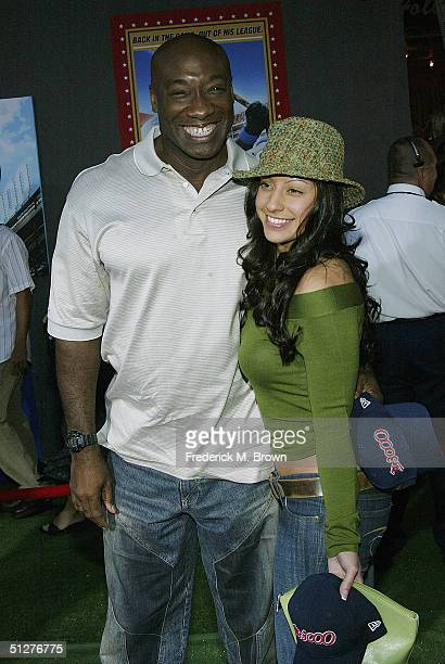 Actor Michael Clarke Duncan and Irene Marquez attend the film premiere of Mr 3000 at the El Capitan Theatre on September 8 2004 in Hollywood...