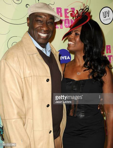 Actor Michael Clarke Duncan and Omarosa ManigaultStallworth attend Perez Hilton's Mad Hatter tea party birthday celebration on March 24 2012 in Los...