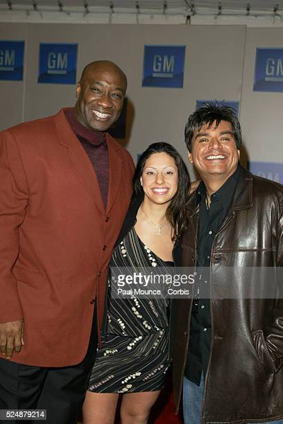 """Actor Michael Clarke Duncan, his wife Irene, and actor and comedian George Lopez arrive at the third annual """"Ten"""" fashion show and charity event..."""