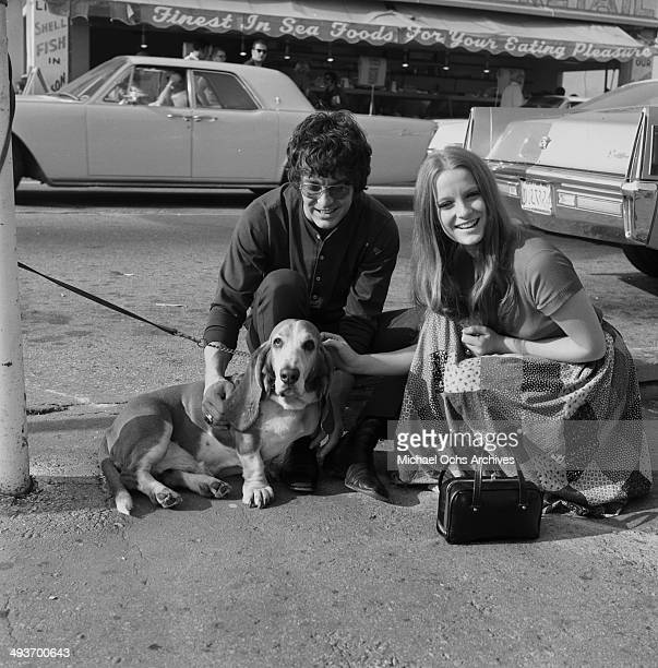 Actor Michael Cole poses with basset hound and Claudia Jennings in Los Angeles California