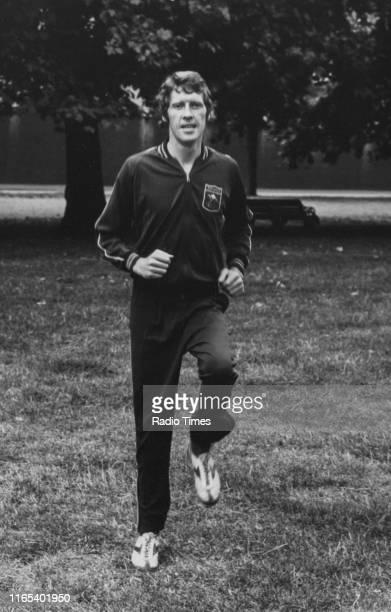 Actor Michael Crawford jogging in the park circa 1975